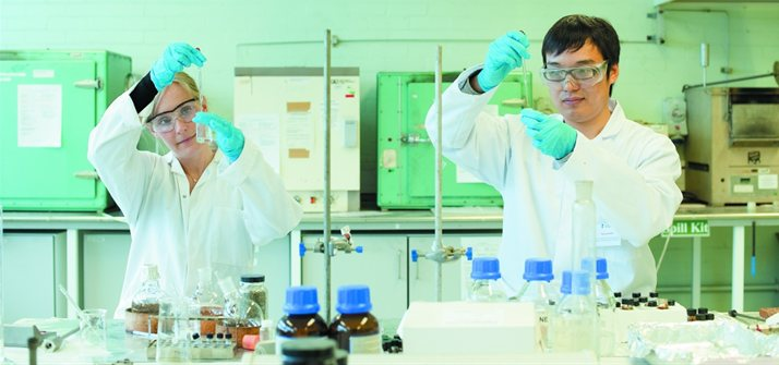 Two students studying carbon capture in a UoN laboratory